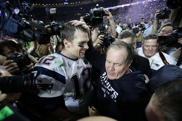 Tom Brady and Bill Belichick embrace after winning the Super Bowl