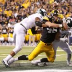 Iowa Falters Late in Close B1G Title Game