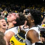Hawkeyes dominate 5th-ranked Michigan, 74-59.
