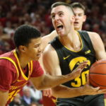 DOWN GOES HILTON: Iowa snaps 8-game road skid against Iowa State, 84-68